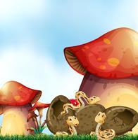 Cena de jardim com três cobras e cogumelos
