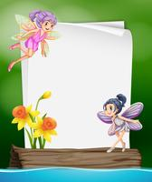 Paper template with two fairies flying vector