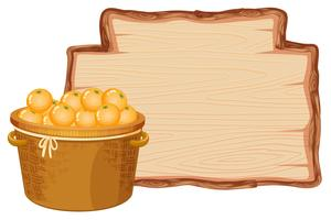 Orange basket on wooden board