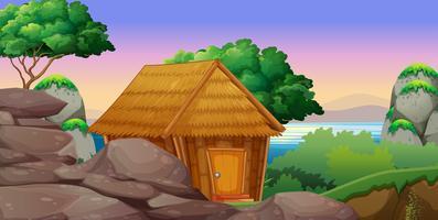 Aardscène met hut door het meer