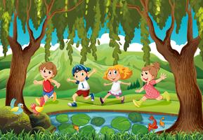 Four kids running in the park