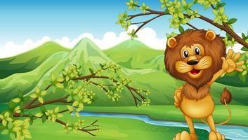 Um leão em frente ao rio e às altas montanhas