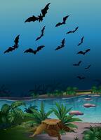 Escena con murciélagos volando sobre el estanque
