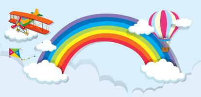 Airplane and balloon over the rainbow