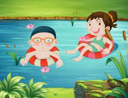 Two kids swimming in the river