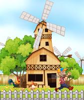 Farmer and chickens by the windmill