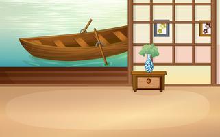 Roddbåt som flyter utanför huset
