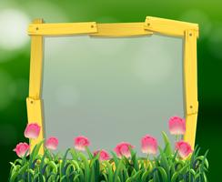 Wooden frame with pink tulip flowers