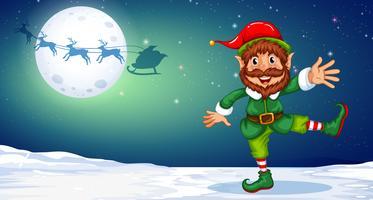Elfo di Natale che balla nella neve