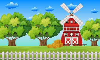 Farm scene with windmill in the field