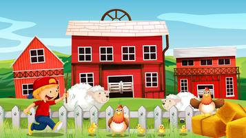 Niño y animales de granja en la granja.