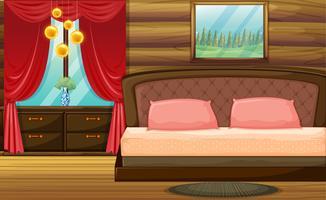 Habitación con cama de madera y cortina roja.