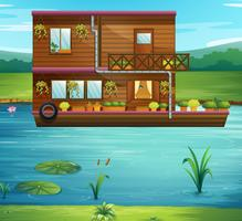 Boat house floating on the river