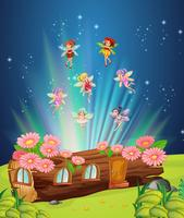 Fairies flying over the log house