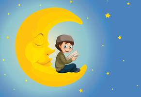 A muslim boy reading on the moon