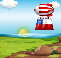 A floating balloon travelling with the flag of Chile vector
