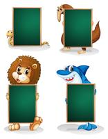 Four animals holding an empty board