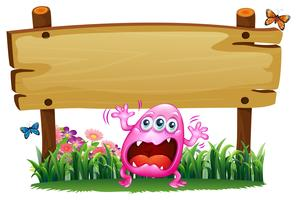 A scared pink monster under the wooden signboard