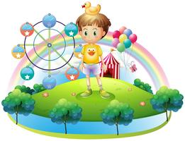 A boy with a rubber duck in an island with a carnival vector