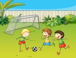 Kinderen voetballen op voetbalveld