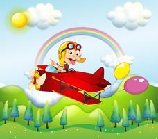 Una scimmia cavalcando un aereo rosso con due palloncini