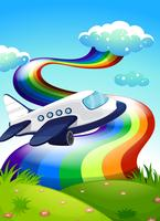 A jetplane near the hilltop with a rainbow