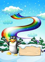 A penguin near the empty signboard and a rainbow in the sky