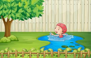 A girl swimming inside the fence