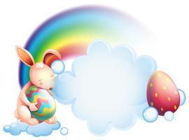 Un coniglio che tiene un uovo mentre dorme davanti a un arcobaleno