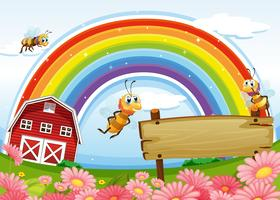 A farm with an empty wooden board and a rainbow uphigh