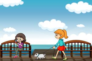 Two girls near the sea vector