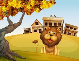 Un león frente a una casa de madera.