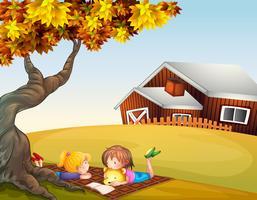 Kinderen lezen onder een grote boom