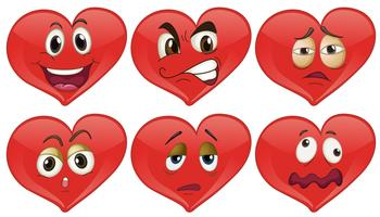 Red hearts with facial expressions vector