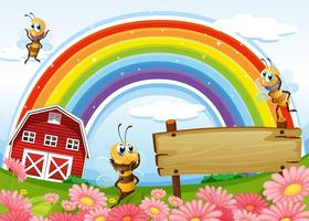 An empty signboard at the hilltop with a barnhouse and a rainbow