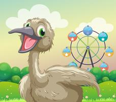 An ostrich in front of the ferris wheel