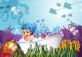 Uma banheira no fundo do mar com uma sereia