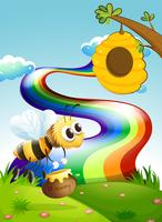 A bee carrying a pot of honey going to the beehive near the rainbow