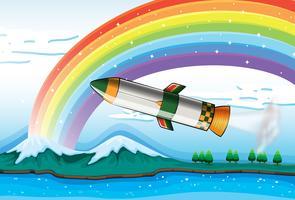 Een regenboog boven de oceaan en een vliegtuig