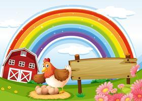 Ein Bauernhof mit einem Regenbogen und einem leeren Schild