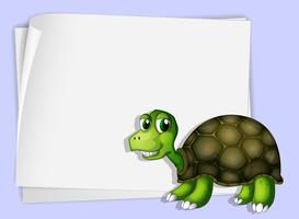 A turtle beside an empty paper