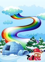 A rainbow above the igloo beside the reindeer