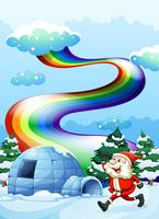 A happy Santa walking near the igloo under the rainbow