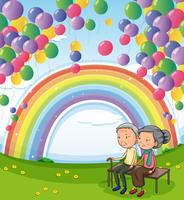 An old couple below the floating balloons and the rainbow