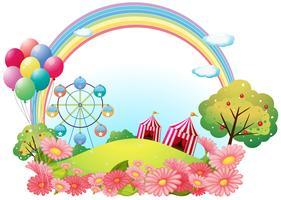Una collina con tende da circo, palloncini e una ruota panoramica
