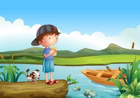 Un garçon et un chien au-dessus d'un tronc flottant