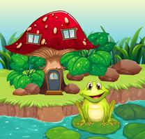 A frog above a waterlily in front of a mushroom house