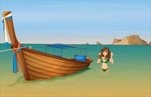 Een meisje in de buurt van de houten boot