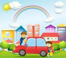 Een vader en een zoon die de rode auto schoonmaken
