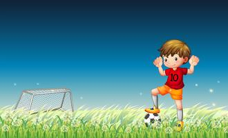 A boy playing soccer vector